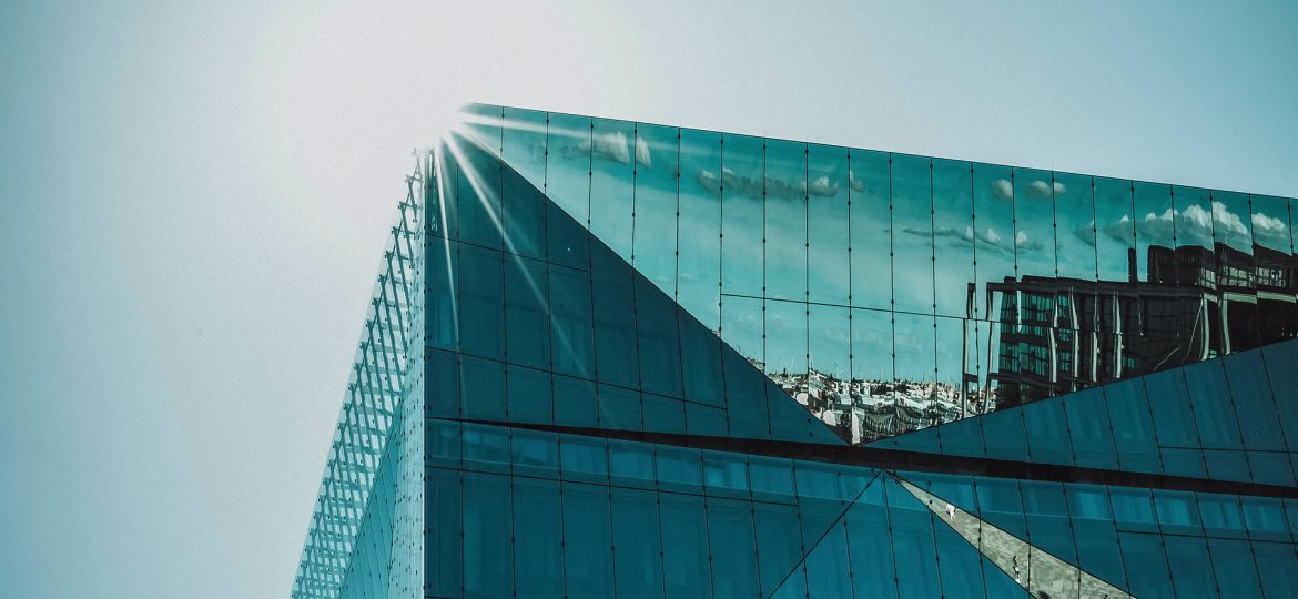 A glass building shining in the sun